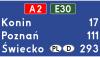 Znak E-14a: tablica szlaku drogowego na autostradzie